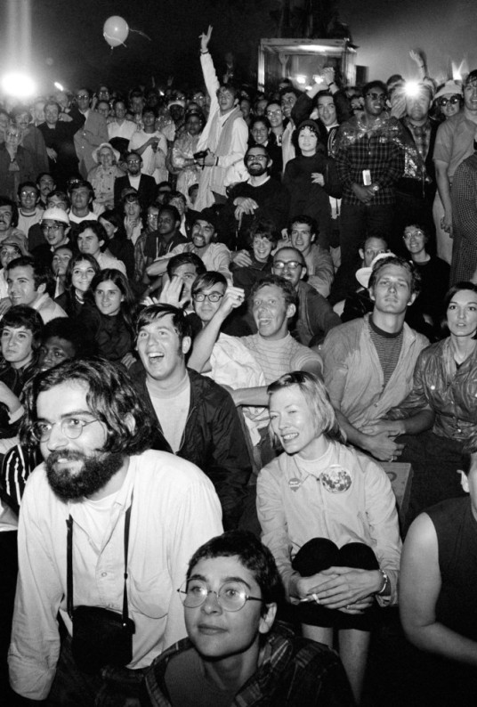 USA. NYC. July 20th, 1969. Crowds watch the first moonwalk on huge screens set up in Central Park.